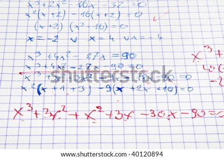 maths calculations with teacher's corrections in red - stock photo