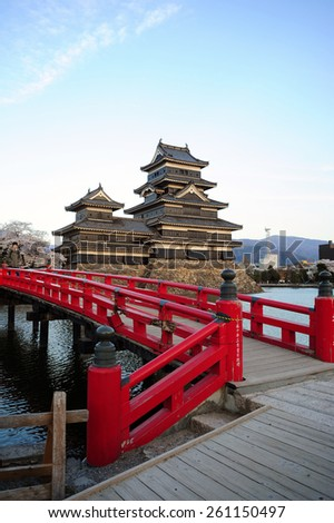 MATSUMOTO, JAPAN - APRIL 14 : Matsumoto Castle with red bridge taken April 14, 2014. The Castle is popular tourist spot in Matsumoto province. - stock photo
