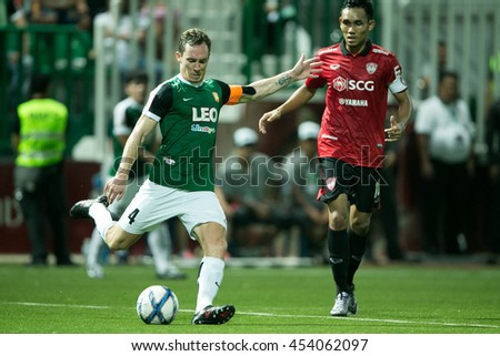 Matt Smith no.4 (L) of Bangkok Glass FC. in action during  theThai Premier League 2016 Bangkok Glass FC.and Muangthong United at Leo Stadium on June 29,2016 in Thailand - stock photo