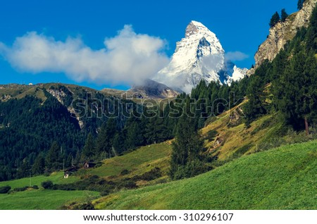 Matterchorn with clouds at landscape. Alps. Swiss - stock photo