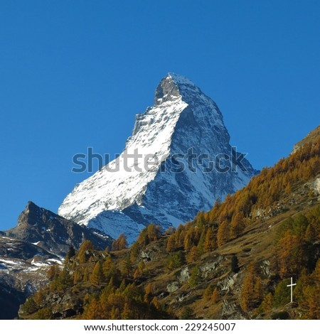 Matterhorn and yellow larch forest - stock photo