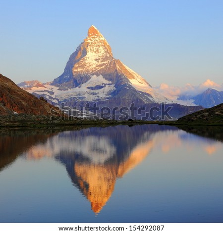 Matterhorn peak with reflection on Riffelsee, Switzerland - stock photo