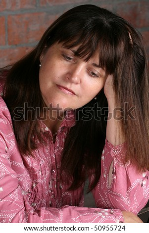 Mature adult female with a serious facial expression - stock photo