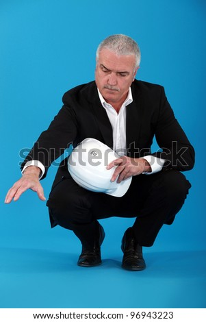 Mature architect with a serious face. - stock photo