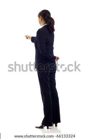 Mature Asian business woman pointing at something over white - stock photo