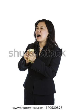 Mature Asian woman in an angry mood on white background - stock photo