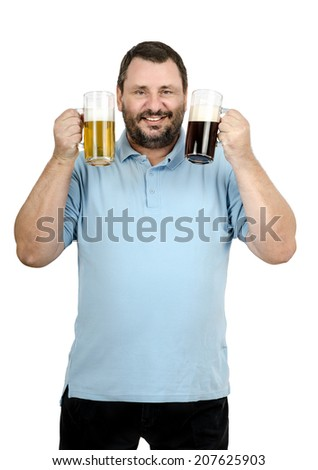 Mature bearded man holding one mug of light ale and other with dark stout - stock photo