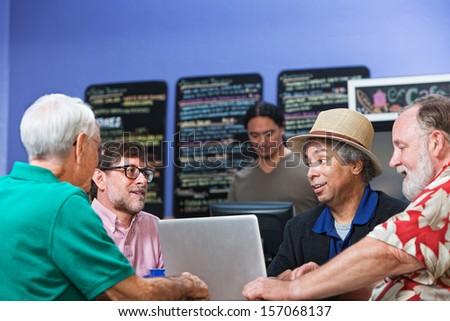 Mature Black man talking with Caucasian friends - stock photo