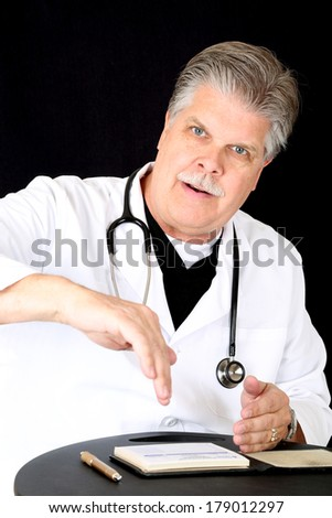 mature blue eyed medical doctor consulting patient  - stock photo