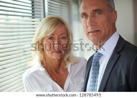 Mature business couple - stock photo