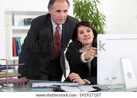 Mature business couple - stock photo