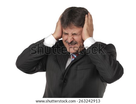 Mature business man standing isolated on white background with a headache - stock photo