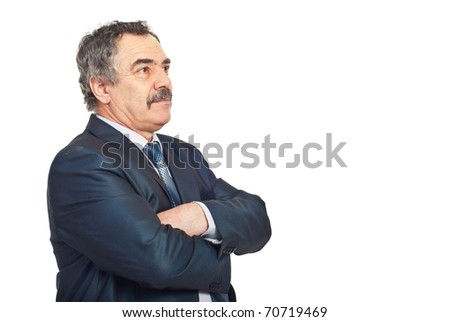 Mature business man standing with hands crossed and looking away to copy space and thinking isolated on white background - stock photo
