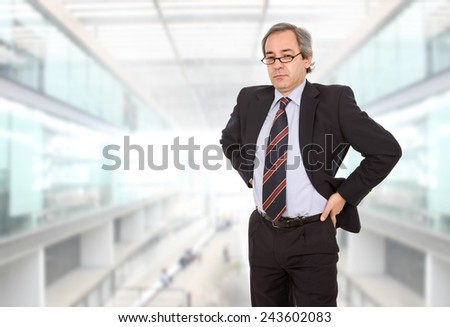 mature business man thinking at the office - stock photo