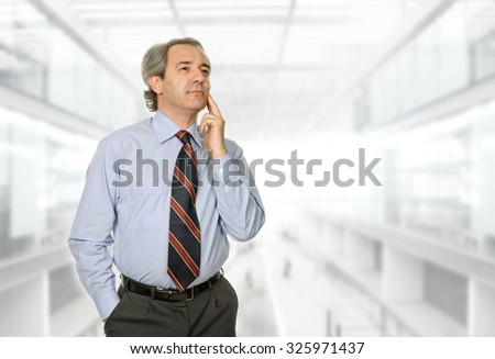 mature business man thinking, at the office - stock photo