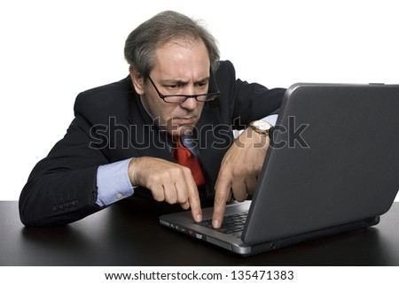 mature business man working with his laptop - stock photo