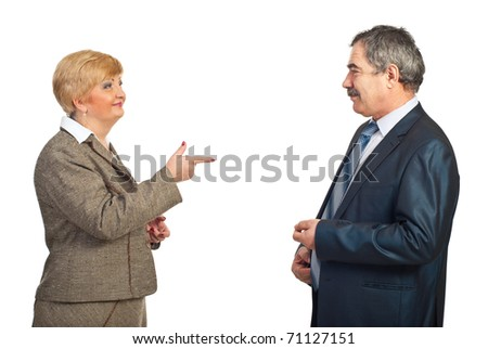 Mature business woman pointing to his colleague man and smiling isolated on white background - stock photo