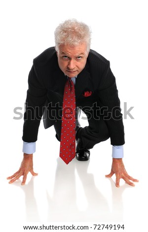 Mature businessman at starting line isolated over white background - stock photo