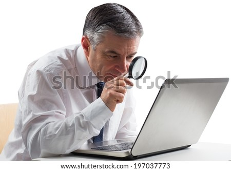 Mature businessman examining with magnifying glass on white background - stock photo