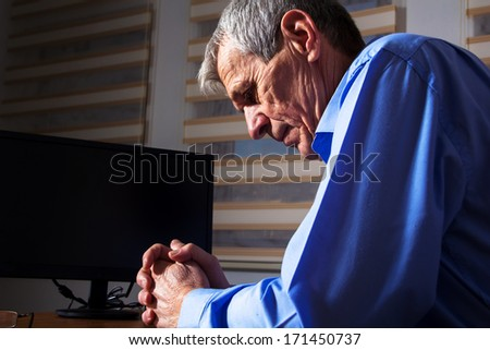 Mature Businessman has a problem at his work - stock photo