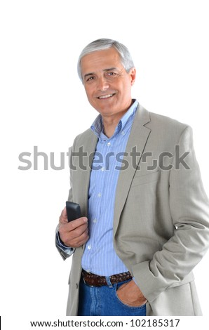 Mature businessman in casual attire holding a cell phone. - stock photo