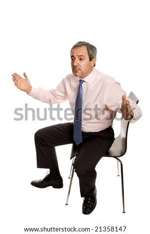 mature businessman on a chair, isolated on white - stock photo