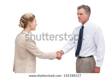 Mature businessman shaking hands with his coworker on white background - stock photo
