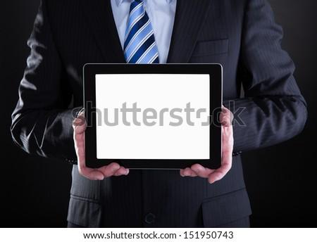 Mature Businessman Showing Digital Tablet Over Black Background - stock photo