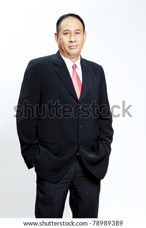 Mature businessman standing on white background - stock photo