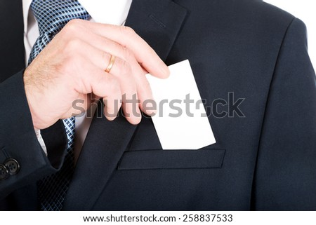 Mature businessman taking a blank card from pocket. - stock photo