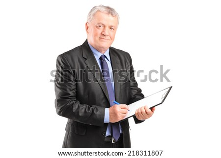 Mature businessman taking notes on piece of paper isolated on white background - stock photo