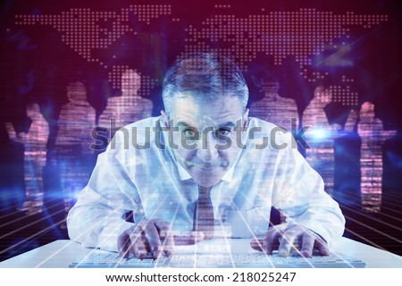 Mature businessman typing on keyboard against white silhouettes on black background - stock photo