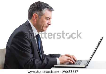 Mature businessman using his laptop on white background - stock photo