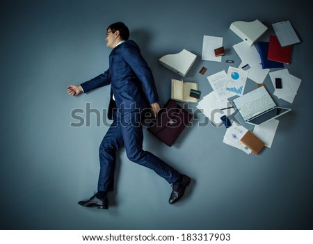 Mature businessman with briefcase in studio - stock photo