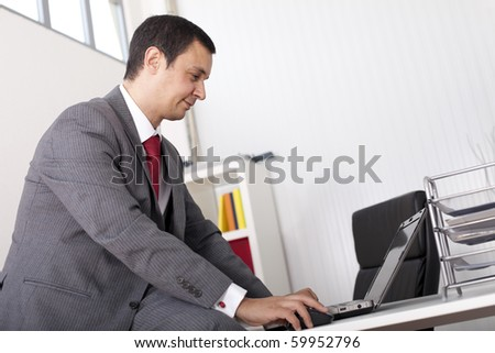 Mature businessman working at the office - stock photo