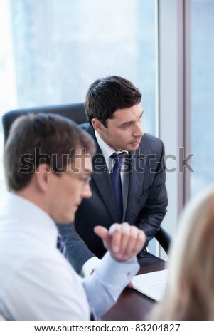 Mature businesspeople in office - stock photo