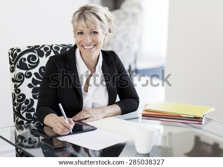 Mature Businesswoman Working At Home - stock photo
