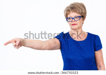Mature Caucasian woman gesturing with forefinger to copy space, white background - stock photo