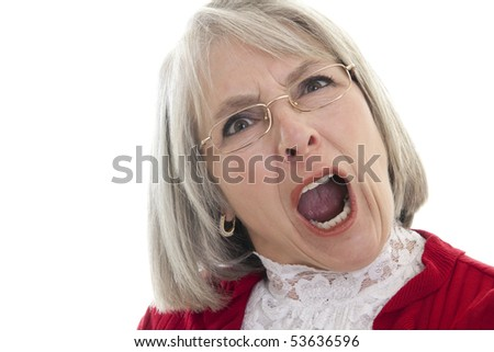 Mature Caucasian woman yelling with an angry expression - stock photo