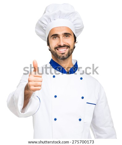 Mature chef thumbs up - stock photo