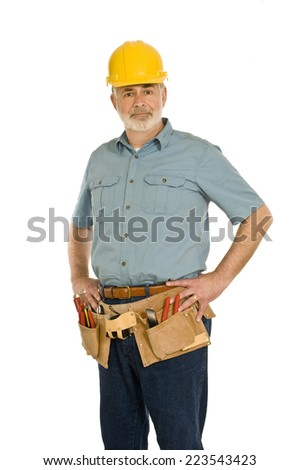 Mature Construction Worker With Toolbelt And Hard Hat - stock photo
