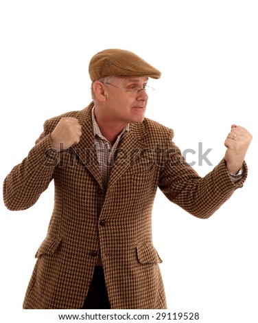 Mature country gent in tweeds - want to fight? - stock photo