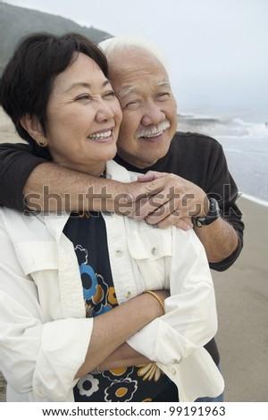 Mature Couple at Beach - stock photo