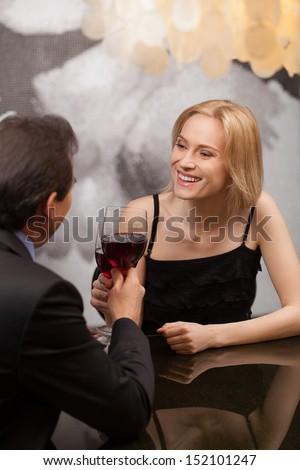 Mature couple at the restaurant. Beautiful middle aged couple drinking red wine at the restaurant - stock photo