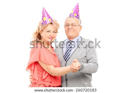 Mature couple dancing at some party isolated on white background - stock photo
