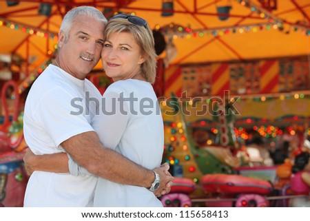 Mature couple embracing - stock photo
