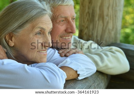 mature couple   in summer park - stock photo