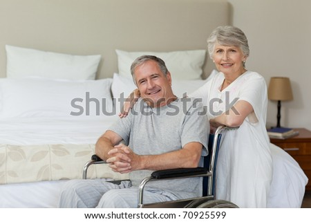 Mature couple in their bedroom - stock photo