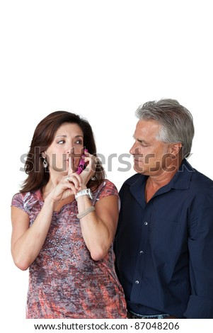 Mature couple on cell phone with a secret. - stock photo