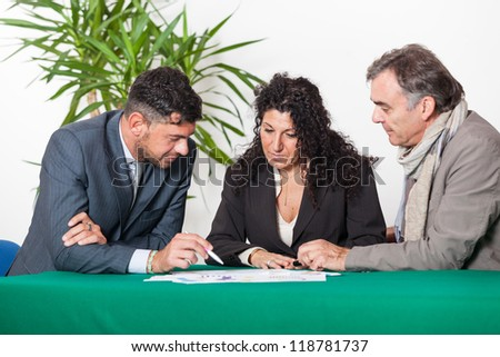 Mature Couple with Financial Consultant - stock photo